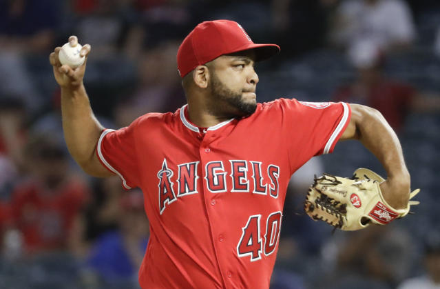 Los Angeles Angels starting pitcher Odrisamer Despaigne throws against the Seattle Mariners during the first inning of a baseball game in Anaheim, Calif., Thursday, Sept. 13, 2018. (AP Photo/Chris Carlson)