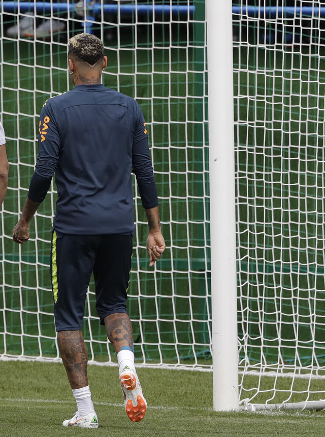 Brazil's Neymar leaves a training session because of pain in his right ankle, in Sochi, Russia, Tuesday, June 19, 2018. Brazil will face Costa Rica on June 22 in the group E for the soccer World Cup. (AP Photo/Andre Penner)