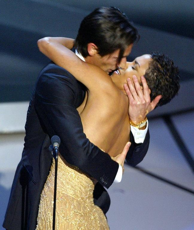 "Actor Adrien Brody kisses presenter Halle Berry as he accepts his best actor Oscar in 2003 for his role in ""The Pianist"""