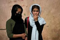 A series of blasts outside a school during a peak holiday shopping period killed more than 50 people, mostly girl students, in west Kabul