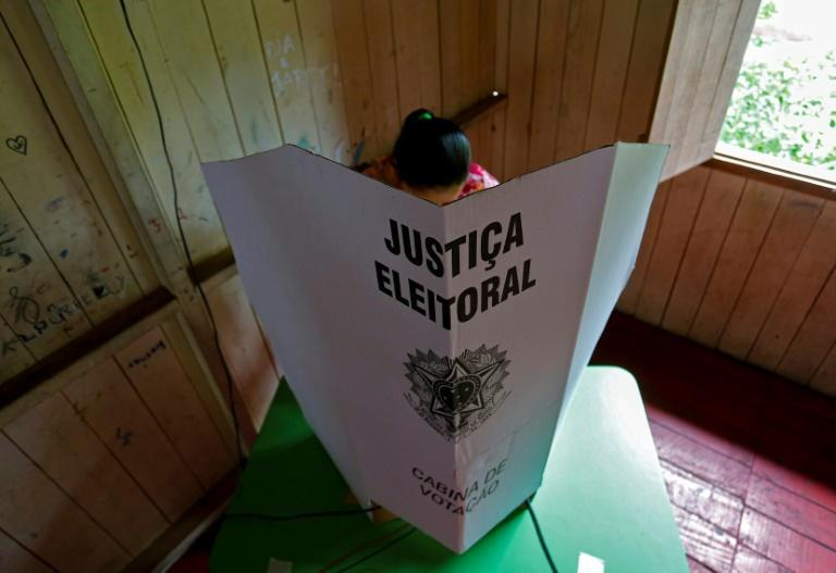 A woman votes in Brazil's municipal elections that saw several transgender candidates win seats
