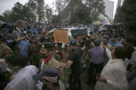 Soldiers carry the national flag-wrapped casket of Pakistani nuclear scientist Abdul Qadeer Khan during his funeral prayer, in Islamabad, Pakistan, Sunday, Oct. 10, 2021. Khan, a controversial figure known as the father of Pakistan's nuclear bomb, died Sunday of COVID-19 following a lengthy illness, his family said. He was 85. (AP Photo/Anjum Naveed)