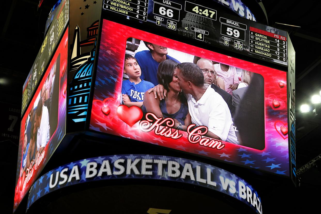 Barack and Michelle Obama on the kiss cam screen during a timeout in an Olympic basketball exhibition game between the U.S. and Brazil men's teams in Washington on July 16, 2012.
