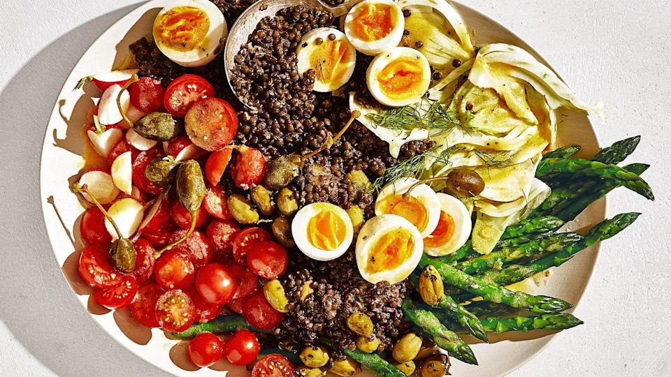"""To make this endlessly riffable salad, pair whatever produce you've got with 7-minute eggs, a mustardy dressing you can make ahead, a protein, and almost any veg: beans, asparagus, fennel, to name a few. <a href=""""https://www.bonappetit.com/recipe/lentil-nicoise-salad?mbid=synd_yahoo_rss"""" rel=""""nofollow noopener"""" target=""""_blank"""" data-ylk=""""slk:See recipe."""" class=""""link rapid-noclick-resp"""">See recipe.</a>"""