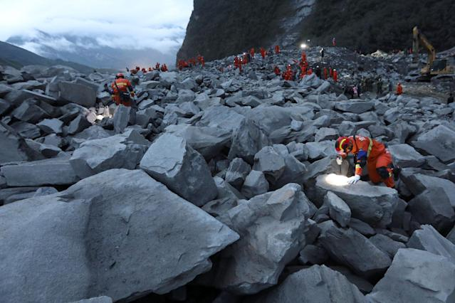 <p>Rescue workers search for survivors at the site of a landslide that occurred in Xinmo Village, Mao County, Sichuan province, China, June 24, 2017. (Photo: Stringer/Reuters) </p>