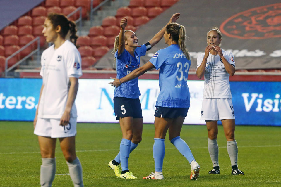 Chicago Red Stars' Rachel Hill (5) celebrates with teammate Katie Johnson (33) after scoring against the Sky Blue during the first half of an NWSL Challenge Cup soccer semifinal match Wednesday, July 22, 2020, in Sandy, Utah. (AP Photo/Rick Bowmer)