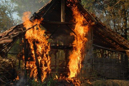 A burning house in Sampang, East Java, on August 26. A mob attack on Shiites in Indonesia saw two men killed with sickles and dozens of homes torched, police and a human rights group said Monday, in the latest sign of rising intolerance in the world's largest Muslim country