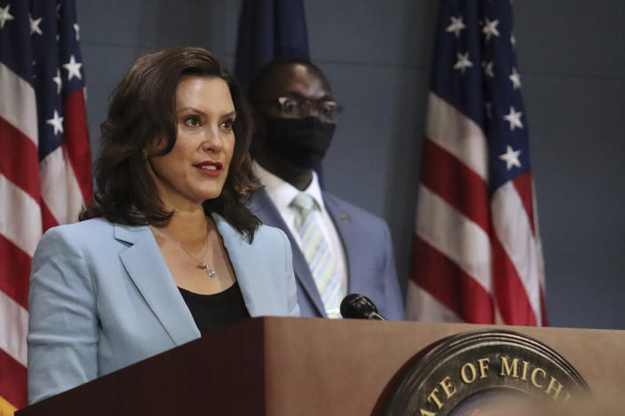 FILE -This July 9, 2020 file photo provided by the Michigan Office of the Governor shows Michigan Gov. Gretchen Whitmer as she addresses the state during a speech in Lansing, Mich. Gov. Whitmer on Friday, July 10, 2020, toughened a requirement to wear masks during the coronavirus pandemic, mandating that businesses open to the public deny service or entry to customers who refuse to wear one. The governor also expanded where people must have a face covering beyond indoor public spaces. Starting immediately, they have to wear one outdoors if they cannot consistently keep 6 feet from non-household members, and while using public transportation, a taxi or a ride-sharing vehicle — with some exceptions. (Michigan Office of the Governor via AP, Pool)