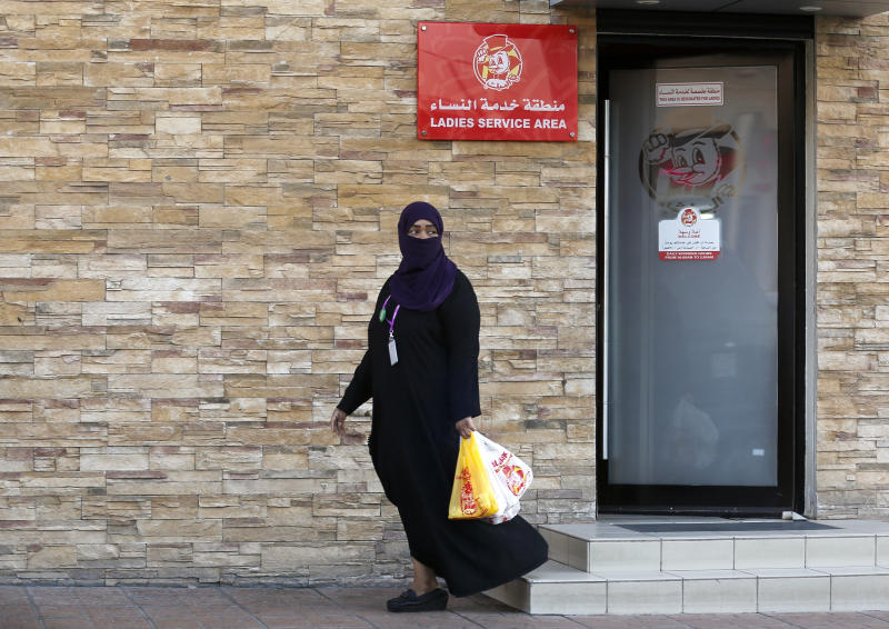 A woman leaves a ladies only service area at a restaurant in Jiddah, Saudi Arabia, Sunday, Dec. 8, 2019. Women in Saudi Arabia will no longer need to use separate entrances from single men or sit behind partitions at restaurants and cafes in the latest measure announced Sunday by the government that upends a major hallmark of the conservative restrictions that had been in place for decades. (AP Photo/Amr Nabil)