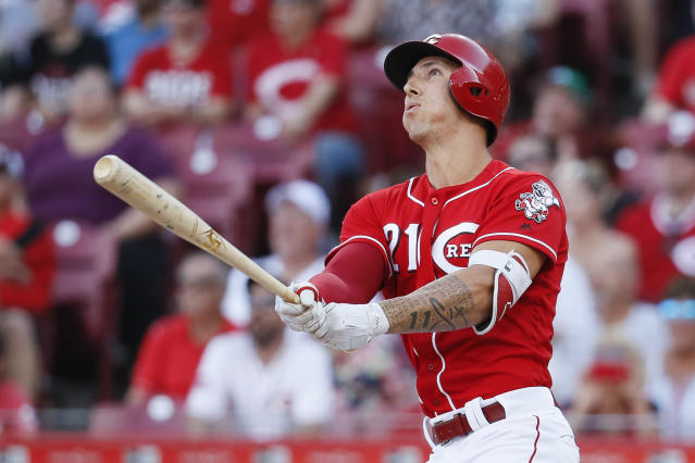 Cincinnati Reds' pitcher Michael Lorenzen follows through on his pinch-hit grand slam against the Milwaukee Brewers. (AP)
