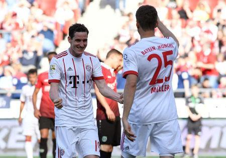 Soccer Football - Bundesliga - Hannover 96 vs Bayern Munich - HDI-Arena, Hanover, Germany - April 21, 2018 Bayern Munich's Sebastian Rudy celebrates scoring their third goal with Thomas Mueller REUTERS/Fabian Bimmer