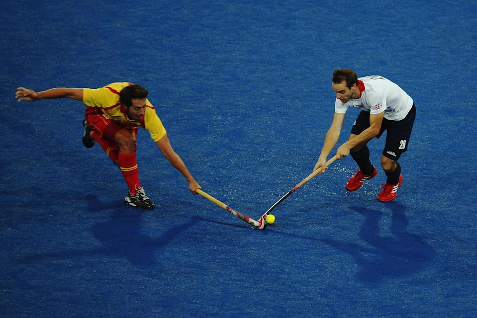 LONDON, ENGLAND - AUGUST 07: Nicholas Caitlin of Great Britain and Ramon Allegre of Spain challenge for the ball during the Men's Hockey match between Great Britain and Spain on Day 11 of the London 2012 Olympic Games at Riverbank Arena Hockey Centre on August 7, 2012 in London, England. (Photo by Daniel Berehulak/Getty Images)