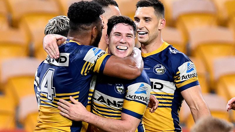 Waqa Blake and Mitchell Moses, pictured here celebrating as the Eels thrash the Broncos in the NRL.