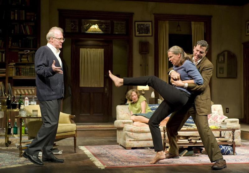 This theater image released by Jeffrey Richards Associates shows, from left, Tracy Letts,  Carrie Coon, Amy Morton, foreground, and Madison Dirks during a performance of Edward Albee's Who's Afraid of Virginia Woolf, opening Oct. 13, 2012 at the Booth Theatre in New York. (AP Photo/Jeffrey Richards Associates, Michael Brosilow)