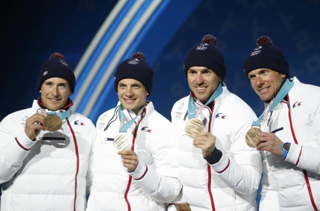Medals Ceremony - Cross-Country Skiing - Pyeongchang 2018 Winter Olympics - Men's 4x10 km Relay - Medals Plaza - Pyeongchang, South Korea - February 18, 2018 - Bronze medalists Jean Marc Gaillard, Maurice Manificat, Clement Parisse and Adrien Backsheider of France on the podium. REUTERS/Kim Hong-Ji