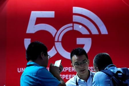 FILE PHOTO: A sign advertising 5G is seen at CES (Consumer Electronics Show) Asia 2019 in Shanghai