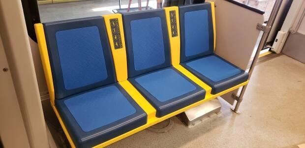 The new seats in the priority seating area come with a splash of yellow.
