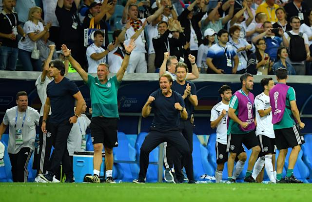 Soccer Football - World Cup - Group F - Germany vs Sweden - Fisht Stadium, Sochi, Russia - June 23, 2018 Germany coach Joachim Low and his coaching staff celebrate victory after the match REUTERS/Dylan Martinez