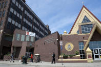 In this June 7, 2020, photo, people walk outside the Salvation Army's Harbor Light Center, Minneapolis' largest homeless shelter, where George Floyd once worked as a security guard. (AP Photo/Julio Cortez)
