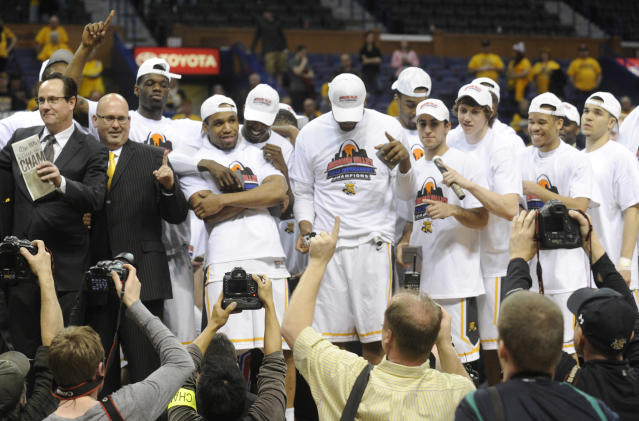 Wichita State coach Gregg Marshall, far left, celebrates with his team after their victory over Indiana State in the an NCAA college basketball game in the championship of the Missouri Valley Conference men's tournament on Sunday, March 9, 2014, in St. Louis. (AP Photo/Bill Boyce)