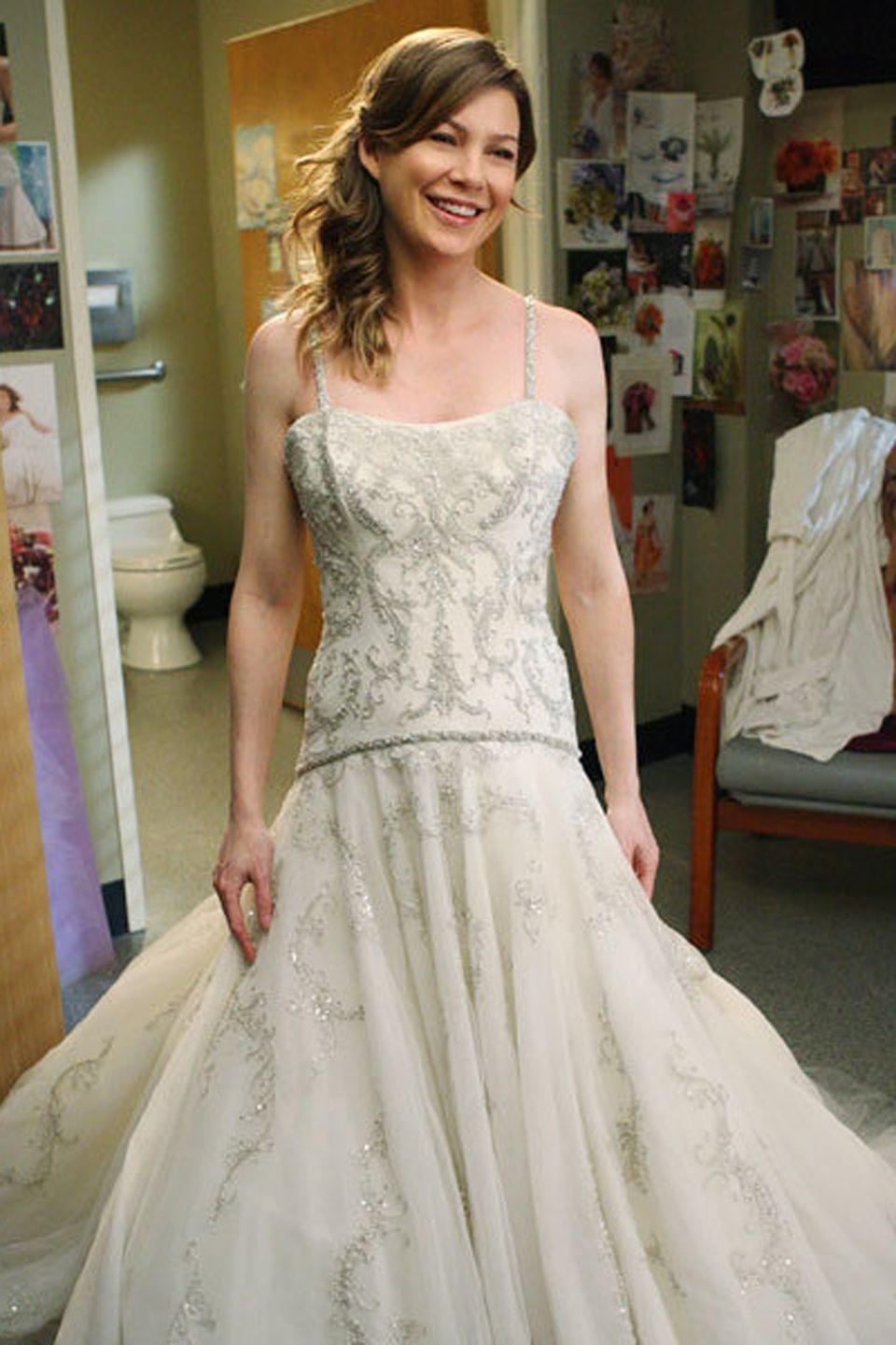 "<p>Meredith opted for an embellished dress with thin straps and a flared skirt <a href=""https://www.brides.com/story/meredith-grey-wedding-dress-greys-anatomy-kenneth-pool"" rel=""nofollow noopener"" target=""_blank"" data-ylk=""slk:by Kenneth Pool"" class=""link rapid-noclick-resp"">by Kenneth Pool</a> to marry Derek Shepard. The two doctors wed in season 5. </p>"