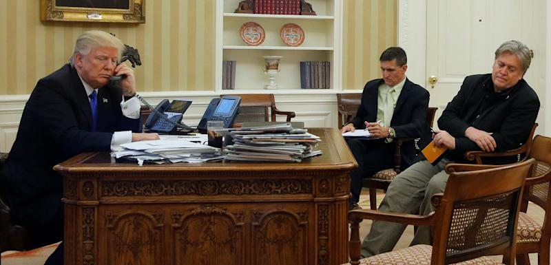 Trump speaks by phone with Australian Prime Minister Malcolm Turnbull in the Oval Office on Jan. 28. (Seated across from him are two advisers who have since left the White House, Michael Flynn and Steve Bannon.)