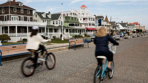 PHOTO: Cyclists ride their bicycles in Cape May, N.J., March 18, 2020. (Matt Rourke/AP)