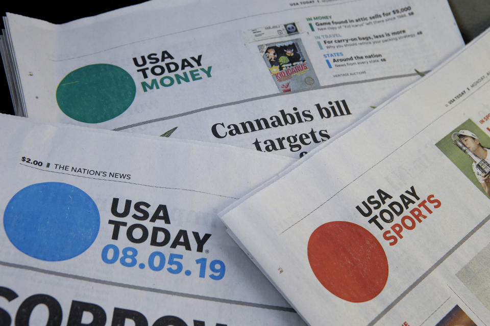 FILE - In this Aug. 5, 2019, file photo, sections of a USA Today newspaper rest together in Norwood, Mass. Gannett Co., Inc. reports earnings Thursday, Feb. 27. (AP Photo/Steven Senne, File)