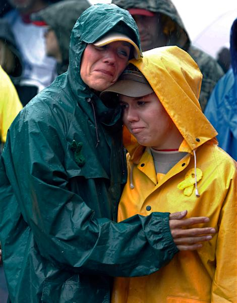 FILE - During a moment of silence, Joan Olsen, left, and her daughter Emily Olsen embrace at the start of the Walk for Suicide Awareness in Kaukauna, Wis. on Saturday, Sept. 11, 2010. Joan and Emily are honoring Chris Olsen, who is Joan's husband and Emily's father. The suicide rate among middle-aged Americans climbed a startling 28 percent in the decade between 1999 and 2010, the government reported Thursday, May 2, 2013, but the rates in younger and older people did not change. (AP Photo/Post-Crescent Media, Dan Powers) MANDATORY CREDIT: POST-CRESCENT MEDIA, DAN POWERS