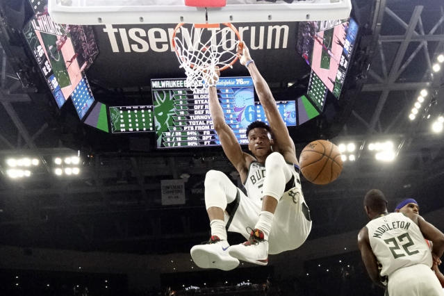 FILE - In this Feb. 22, 2020, file photo, Milwaukee Bucks' Giannis Antetokounmpo dunks during the first half of an NBA basketball game against the Philadelphia 76ers in Milwaukee. The Bucks believe they can build on the momentum they established while producing the NBA's best record before the pandemic-imposed hiatus. (AP Photo/Morry Gash, File)