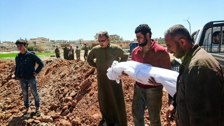 Syrians bury the bodies of victims of a a suspected chemical attack in Khan Sheikhun, a rebel-held town in Syria's northwestern Idlib province, on April 5, 2017