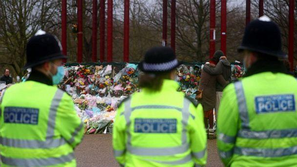 PHOTO: Police officers stand guard at a memorial site at Clapham Common Bandstand, following the kidnap and murder of Sarah Everard, in London, Britain March 15, 2021. (Hannah Mckay/Reuters)