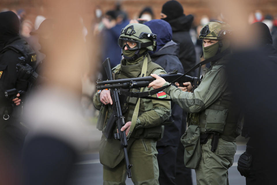 Armed police block demonstrators during an opposition rally to protest the official presidential election results in Minsk, Belarus, Sunday, Nov. 1, 2020. Some thousands of protesters swarmed the streets of the Belarus' capital on Sunday, demanding the resignation of the country's longtime authoritarian leader, and were met with police firing warning shots into the air and using stun grenades to break up the crowds. (AP Photo)