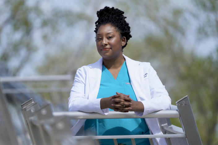 Dr. Brittani James poses for a portrait in the Bronzeville neighborhood of Chicago, Sunday, May 2, 2021. James and her twin, Dr. Brandi Jackson, have taken on the medical establishment in pioneering work to eliminate racism in medicine. (AP Photo/Charles Rex Arbogast)
