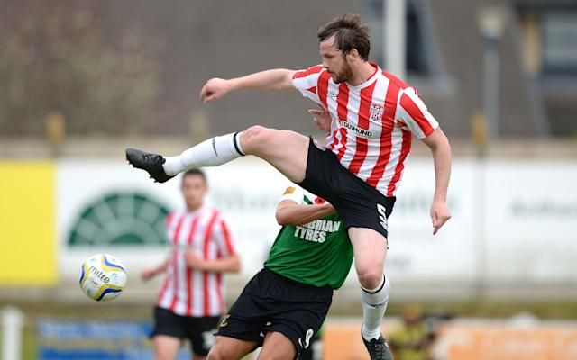<span>McBride in action for Derry</span> <span>Credit: Rex </span>
