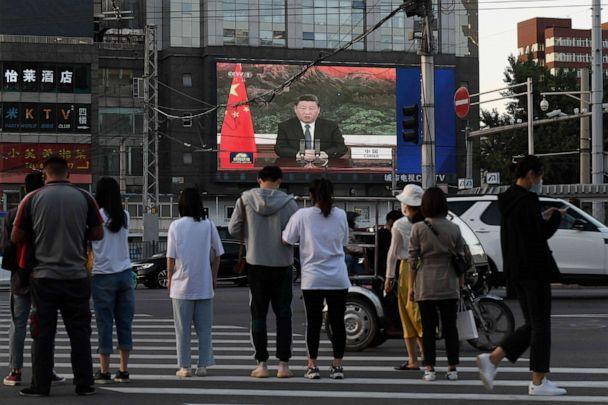 PHOTO: A news program shows Chinese President Xi Jinping speaking via video link to the 73rd World Health Assembly on a giant screen beside a street in Beijing on May 18, 2020. (Greg Baker/AFP via Getty Images)