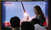 "People watch a TV showing a file image of an unspecified North Korea's missile launch during a news program at the Seoul Railway Station in Seoul, South Korea, Tuesday, Sept. 10, 2019. North Korea launched at least two unidentified projectiles toward the sea on Tuesday, South Korea's military said, hours after the North offered to resume nuclear diplomacy with the United States but warned its dealings with Washington may end without new U.S. proposals. The sign reads "" North Korea launched at least two unidentified projectiles."" (AP Photo/Ahn Young-joon)"