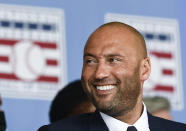 Hall of Fame inductee Derek Jeter, of the New York Yankees, watches a video during an induction ceremony at the Clark Sports Center at the National Baseball Hall of Fame, Wednesday, Sept. 8, 2021, in Cooperstown, N.Y. (AP Photo/Hans Pennink)