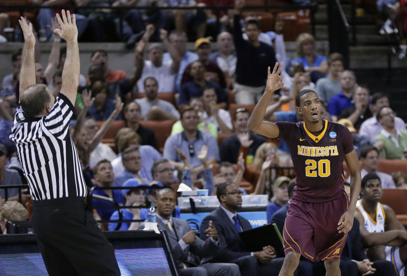Minnesota's Austin Hollins (20) gestures after a 3-point shot against UCLA during the first half of a second-round game of the NCAA men's college basketball tournament Friday, March 22, 2013, in Austin, Texas. (AP Photo/Eric Gay)