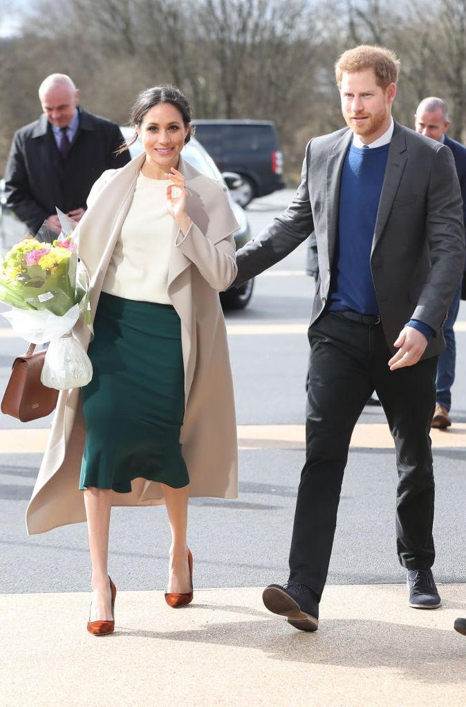 <p>Prince Harry and Meghan Markle made a surprise visit to Northern Ireland on 23 March. For the occasion, the royal-to-be recycled the now-famous Victoria Beckham knit she donned in her engagement portraits. She paid sartorial tribute to the Emerald Isle in a green skirt by Canadian designer Greta Constantine with a Mackage coat. <em>[Photo: Getty]</em> </p>