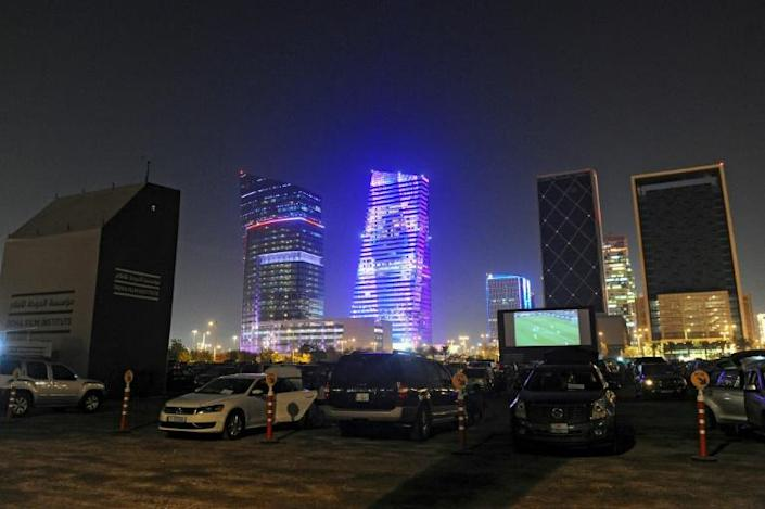 Football fans head to the Doha drive-in to watch the FIFA Club World Cup semi-final between African champions Al Ahly and European giants Bayern Munich