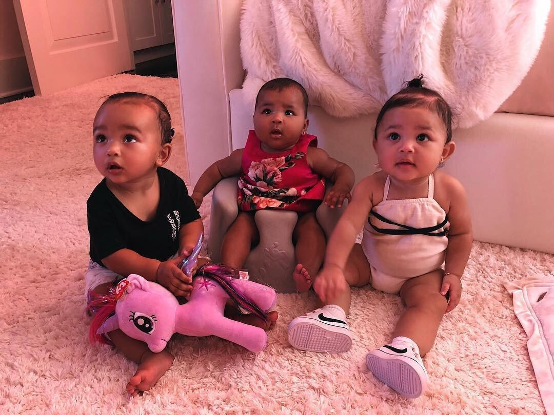 """In September,Kim <a href=""""https://www.instagram.com/p/BnucT8HlycW/"""">shared an adorable photo</a> of daughter Chicago sitting alongside cousinsTrueand Stormi, each looking up wide-eyed.  Captioning <a href=""""https://people.com/parents/kim-kardashian-shares-adorable-first-photo-stormi-chicago-true/"""">the image """"💕 The Triplets 💕,""""</a> Kim capturedKhloé's babyTruesitting in a floor seat alongside<a href=""""https://people.com/tag/kylie-jenner/"""">Kylie Jenner</a>'s daughterStormi, with Chicagoholding a <em>My Little Pony</em> stuffed animal and wearing a black shirt."""