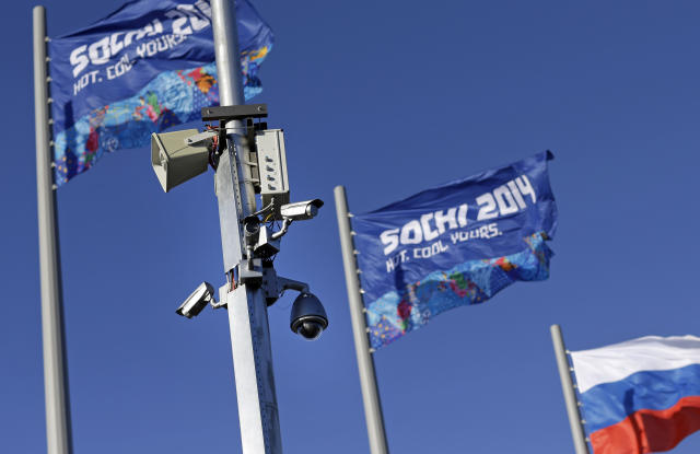 A bank of security cameras hang from a pole in Olympic Park as preparations take place for the 2014 Winter Olympics, Monday, Feb. 3, 2014, in Sochi, Russia. (AP Photo/Patrick Semansky)