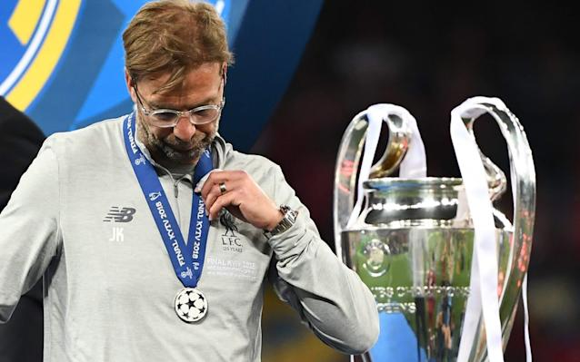 """After Jurgen Klopp's charismatic call for one more game of """"big balls football"""" came the balls-up. Liverpool lost this extraordinary Champions League final not because they were out-played by a Real Madrid side who were making history with a third successive triumph but for reasons to regret; for reasons that will be a maelstrom of frustration on a backdrop of cold hard reality after a remarkable and joyous campaign. Having arrived in Kiev showing the rest of Europe how far they had come, Liverpool left having been exposed as to how far they still need to go. All three goals conceded were ridiculous, of course. One because it was quite probably the best ever scored on such an occasion - but it was sandwiched between two that seemed to define the game as much as Mohamed Salah's gut-wrenching injury. There were 20 passes in the move which ended in Gareth Bale's brilliant over-head kick but this final will forever, also, be unfortunately associated with goalkeeper Loris Karius and a worrying collective shock that Liverpool suffered at the loss of Salah. It will be associated with rivers of tears. But consider for a minute what it must have been like for the players to see Karius blunder in this way? And then also be punished by Bale with his unstoppable goal. Add to that the sickening injury to Salah, their talisman, through an act of professional cynicism from Sergio Ramos, who also shouldered Karius off-the-ball, and it was devastating. Klopp had pondered on the hand of fate in such fixtures and post-match he spoke of Liverpool suffering from """"minus luck"""" such was the collection of set-backs. Real Madrid 3 Liverpool 1 