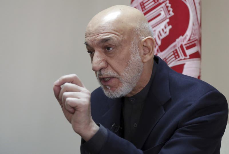 Former Afghan President Hamid Karzai speaks during an interview with The Associated Press in Kabul, Afghanistan, Saturday, Feb. 16, 2019. Karzai expressed fears that a previously unscheduled meeting between the Taliban and the United States in Pakistan on Monday risks engulfing Afghanistan into regional rivalries, as its neighbors and powerful Persian Gulf states jockey for influence in a post- U.S. Afghanistan. (AP Photo/Rahmat Gul)