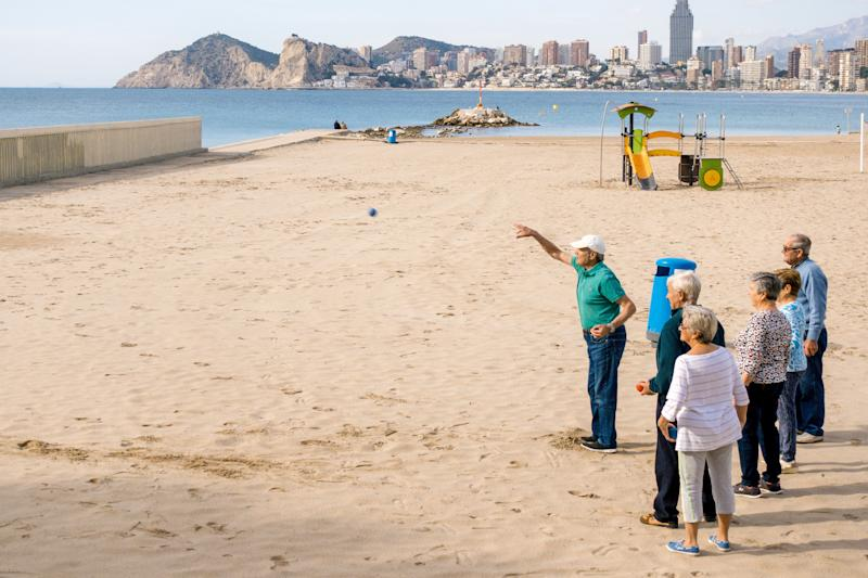 Benidorm, Spain, January 29, 2018: Friendly mature people playing petanque in Benidorm beach.