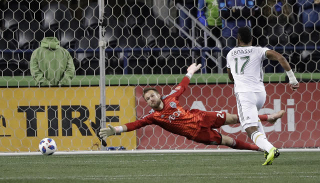 Seattle Sounders goalkeeper Stefan Frei, left can't get to the ball on a goal by Portland Timbers midfielder Sebastian Blanco, not seen, as Timbers' Jeremy Ebobisse (17) watches during the second half of a second-leg MLS playoff soccer match Thursday, Nov. 8, 2018, in Seattle. (AP Photo/Ted S. Warren)