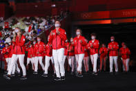 <p>TOKYO, JAPAN - JULY 23: Athletes of Team Canada parade leaded by their flag bearers Miranda Ayim and Nathan Hirayama )not in frame) during the Opening Ceremony of the Tokyo 2020 Olympic Games at Olympic Stadium on July 23, 2021 in Tokyo, Japan. (Photo by Jamie Squire/Getty Images)</p>