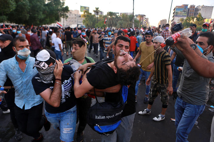 An injured protestor is rushed to a hospital during a demonstration in Baghdad, Iraq, Saturday, Oct. 26, 2019. Iraqi protesters converged on the central square in the capital Baghdad on Saturday as security forces erected blast walls to prevent them from reaching a heavily fortified government area after a day of violence that killed scores. (Photo: Khalid Mohammed/AP)