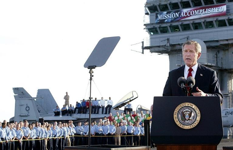 """US President George W. Bush addresses the nation aboard the nuclear aircraft carrier USS Abraham Lincoln in May 2003, declaring a """"mission accomplished"""" in Iraq, despite many years of fighting that followed"""